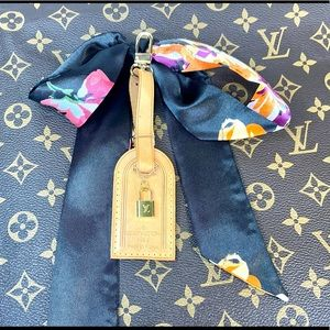Louis Vuitton SMALL leather tag with charm scarf
